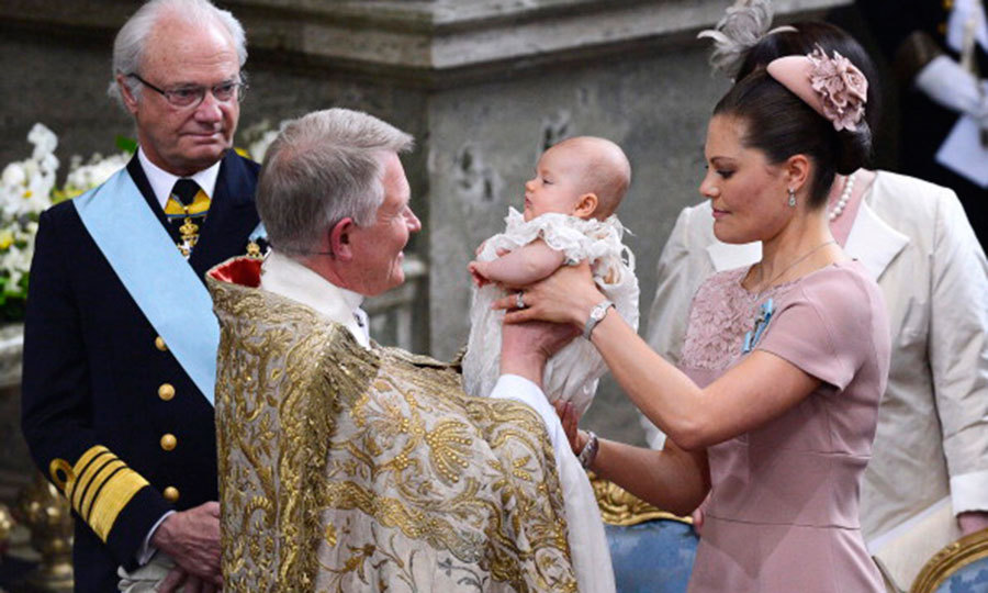 May 2012: The Princess on her big day! Crown Princess Victoria gently handed little Estelle to Archbishop of Uppsala Anders Wejryd during her christening ceremony at the royal chapel in Stockholm.