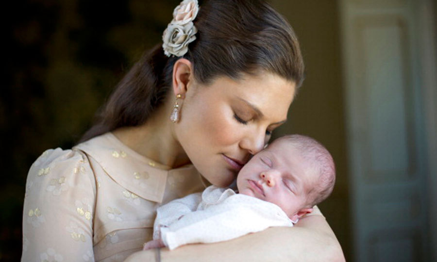 March 2012: Mommy's little girl! At just three weeks old, Estelle posed for this sweet portrait with her mother Crown Princess Victoria. 