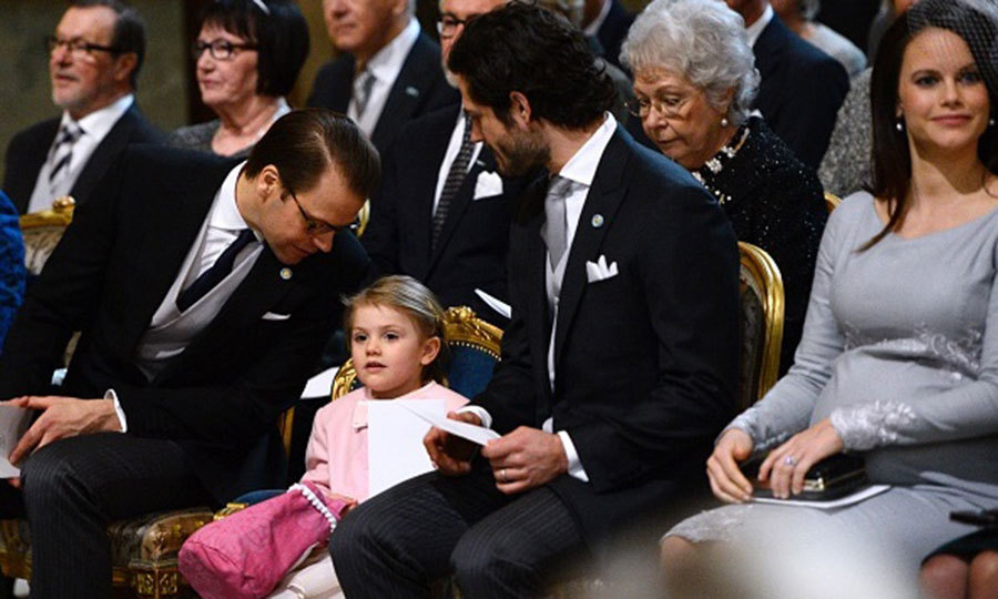 March 2016: All eyes on Princess Estelle! The little girl has the attention of both her dad Prince Daniel and her uncle Prince Carl Philip during a service held in thanksgiving for her newborn brother.