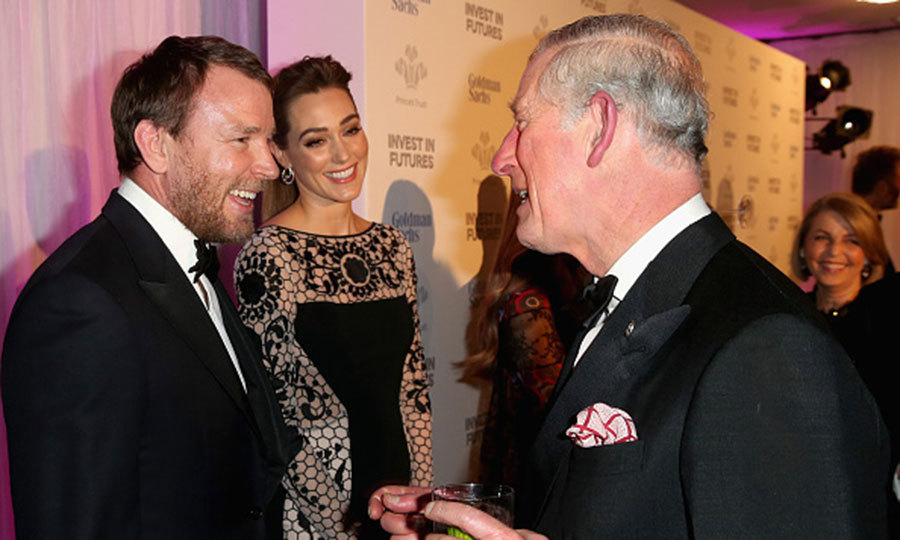 "Movie director <a href=""http://us.hellomagazine.com/tags/1/guy-ritchie/""><strong>Guy Ritchie</strong></a> and his wife Jacqui Ainsley greeted Prince Charles like old friends at a reception for the Prince's Trust Invest in Futures Gala Dinner in February, 2016.
