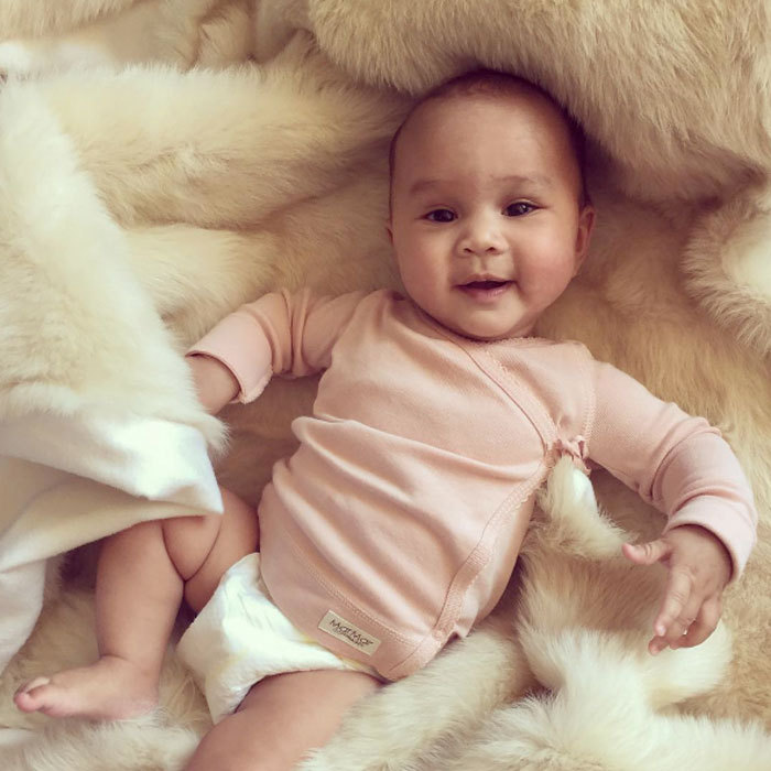 "John Legend shared a photo of his mini-me, daughter Luna, cuddling in a furry blanket. The doting father captioned the adorable snapshot, ""Nothing makes her happier than this blanket.""