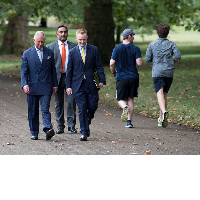 Unbeknownst to two joggers, Prince Charles strolled London's Green Park, while out celebrating the creation of The Queen's Meadow.