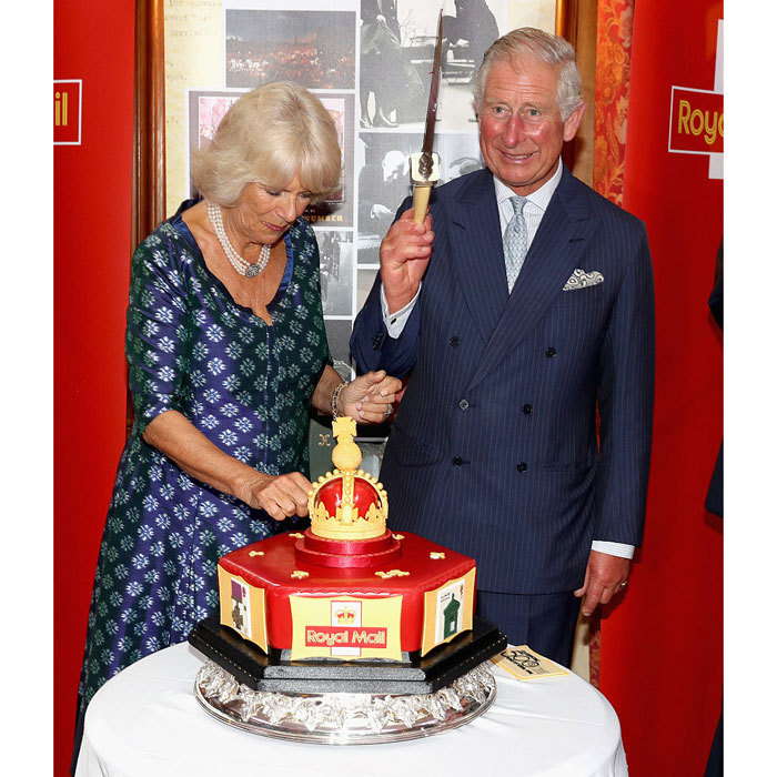 Dig in! Prince Charles excitedly held a knife as he and Camilla prepared to cut into a celebratory Royal Mail 500 cake during a reception to mark the 500th Anniversary of the Royal Mail at Merchant Taylor's Hall.