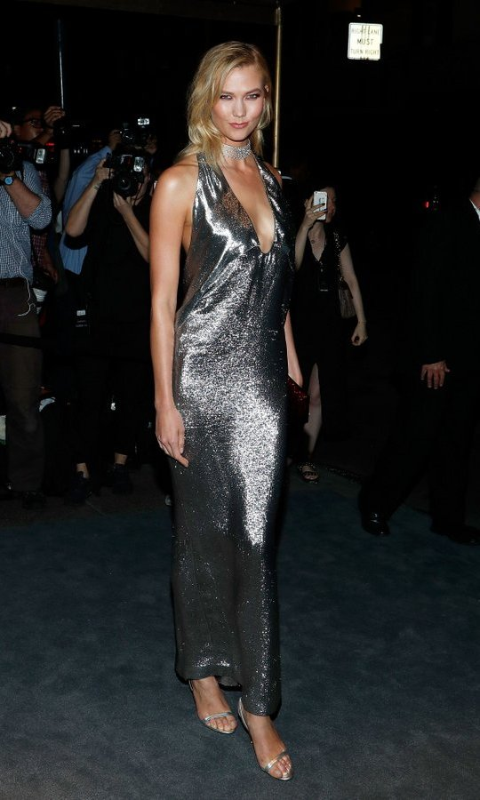 Continuing though the VIP guest list, Karlie Kloss wore a molten silver Tom Ford halter gown to the designer's show.