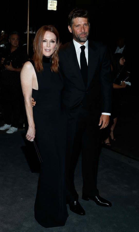 Julianne Moore, who starred in Tom Ford's directorial debut <I>The Single Man</I> which premiered at the Venice Film Festival, brought husband Bart Freundlich to the designer's runway show.