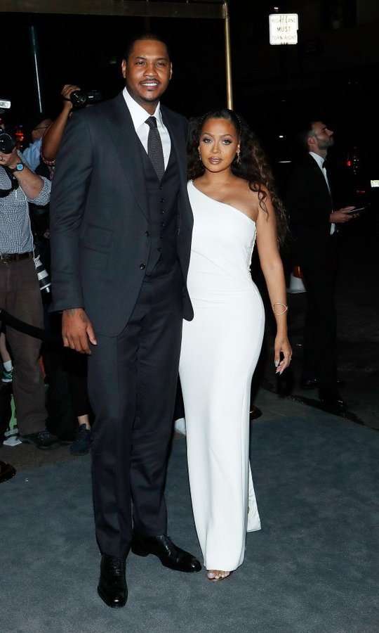Carmelo Anthony and La La Anthony – also looking stunning in white – arrive at the party.