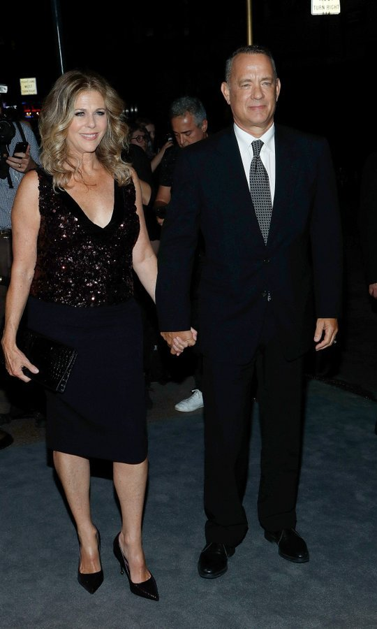 American's favorite couple, Tom Hanks and Rita Wilson walked hand in hand into the Four Seasons for the Tom Ford show.