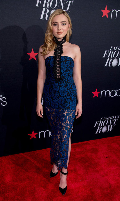 Actress Peyton List donned a black mini that featured a blue lace overlay to the Macy's Presents Fashion's Front Row.