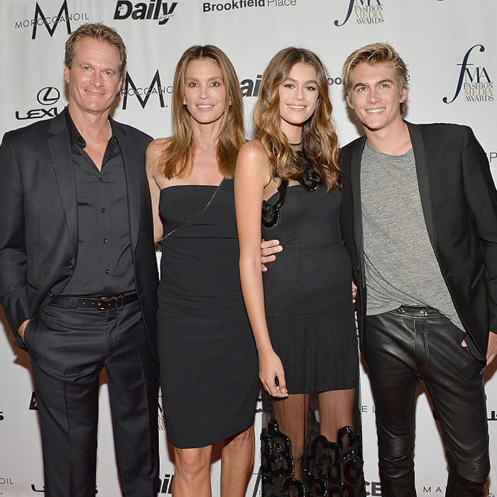Kaia Gerber had the support of her dad Rande Gerber, mom Cindy Crawford and brother Presley Gerber at the FIJI Water x Daily Front Row's Fashion Media Awards, where she was presented with the Female Model of the Year award.