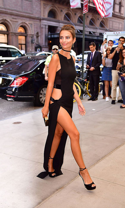 Emily Ratajkowski showed off her toned limbs in a sultry black dress as she made her way into the Park Hyatt New York to attend the Daily Front Row's fourth annual Fashion Media Awards.