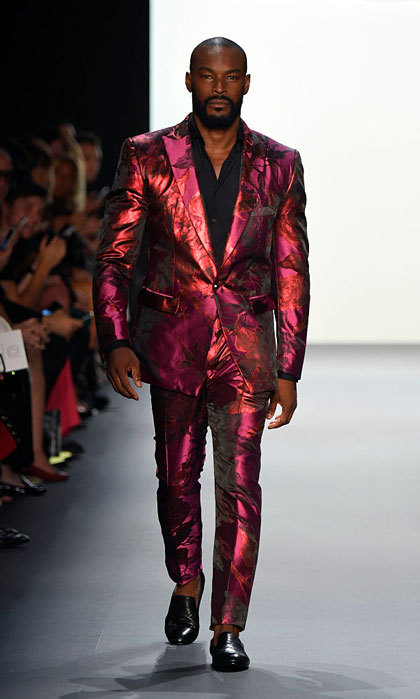 Tyson Beckford modeled a vibrant pink and orange suit at the Michael Costello show.