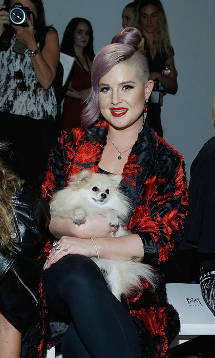 Kelly Osbourne had a furry friend (her Pomeranian dog Polly) with her at the Milly Fashion Show held at the ArtBeam.