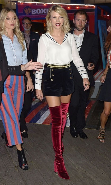 Taylor Swift didn't let the 90 degree temperature stop her from wearing velvet Stuart Weitzman over-the-knee boots to the Tommy Hilfiger fashion show.