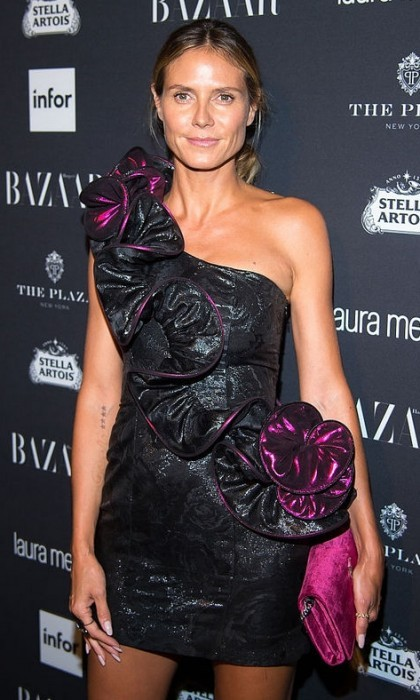 Heidi Klum kept her makeup to a minimum and let her dress be the statement at the Harper's BAZAAR Icons party at the Plaza.