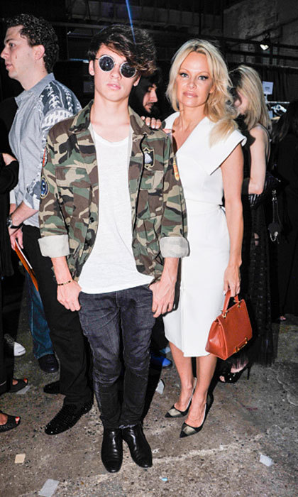 It a mother-son date night for Pamela Anderson and her teenage son Dylan Jagger Lee at the Christian Siriano Fashion show.