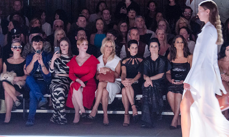 Kelly Osbourne brought her pup out once again for the Christian Siriano show. The TV personality was joined in the front row by Brad Walsh, Coco Rocha, Christina Hendricks, Pamela Anderson, Neve Campbell, Jaimie Alexander and Ashley Graham.