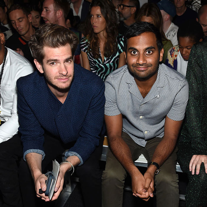 Andrew Garfield and Aziz Ansari (seated in the FROW) were spotted laughing during the FIJI Water x Opening Ceremony fashion show held at the Javits Center.