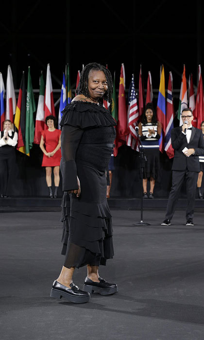 Whoopi Goldberg worked it on the runway at the FIJI Water x Opening Ceremony fashion show. 