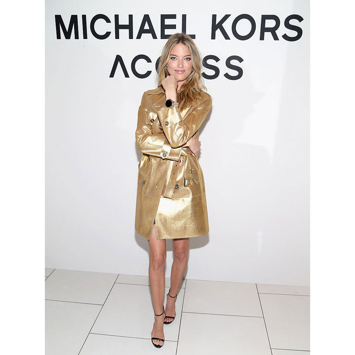VS model Martha Hunt looked <i>golden</i> at the Michael Kors Access Smartwatch launch party in New York City. 