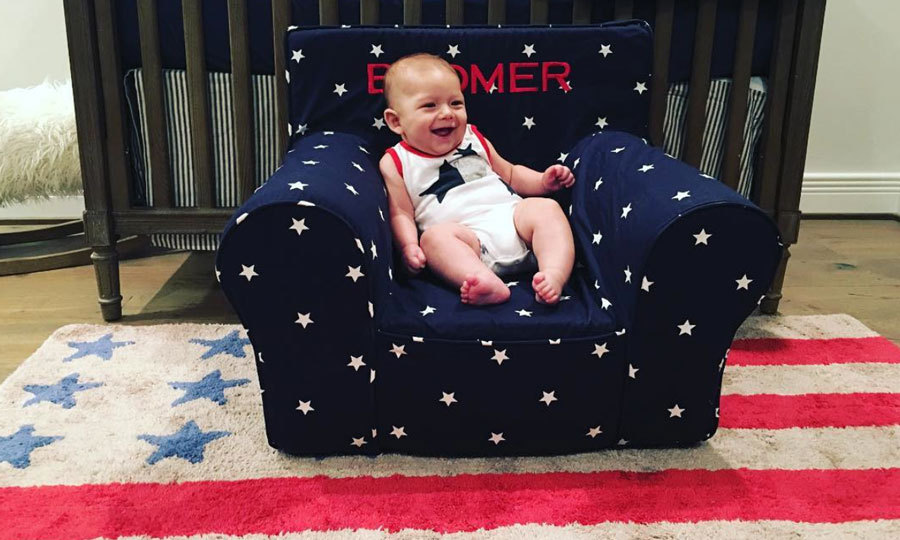 "A throne fit for a king, or son of an Olympian. Boomer laughed as he sat in a patriotic chair embroidered with his named. Attached to the photo posted on his personal Instagram, a message read: ""I love my new chair!!!""