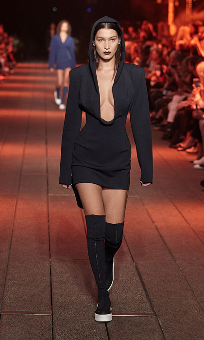 Bella Hadid defined cool on the runway at the DKNY Spring 2017 show modeling a plunging black mini dress on the High Line.
