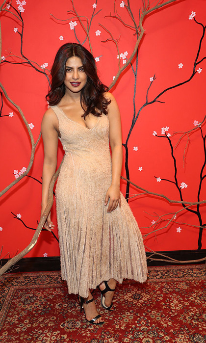 <i>Quantico</i> actress exuded femininity wearing a simple blush dress to the HUGO BOSS and W Magazine celebrate 'THE SHOT' event held at the International Center of Photography Museum.