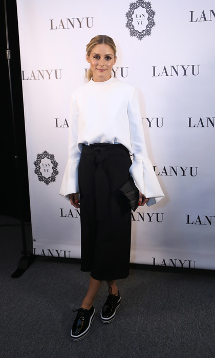 Olivia Palermo looked polished backstage at the Lanyu fashion show wearing a monochromatic outfit.