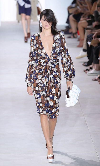 Flower power! Kendall Jenner rocked the runway in a twist front knot dress at the Michael Kors show.