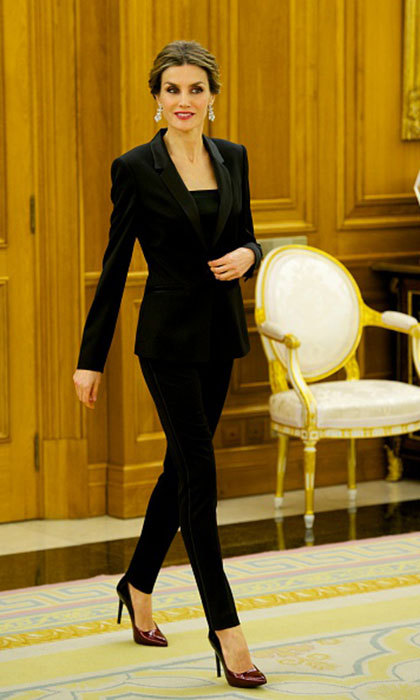 Does Queen Letizia look perfect in <i>everything?</I>. Her take on the masculine trend was on point at a cancer conference at Zarzuela Palace in 2015.