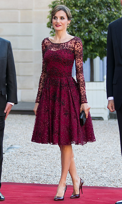 Queen Letizia's 2015 trip to France gave her a chance to show off many of the more glam pieces in her wardrobe, like this burgundy cocktail dress. 