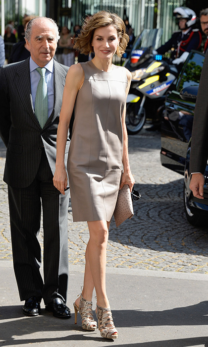Queen Letizia loves a good leather dress! Here she is in one of her faves, along with reptile-print slingbacks, during her 2015 visit to Paris.