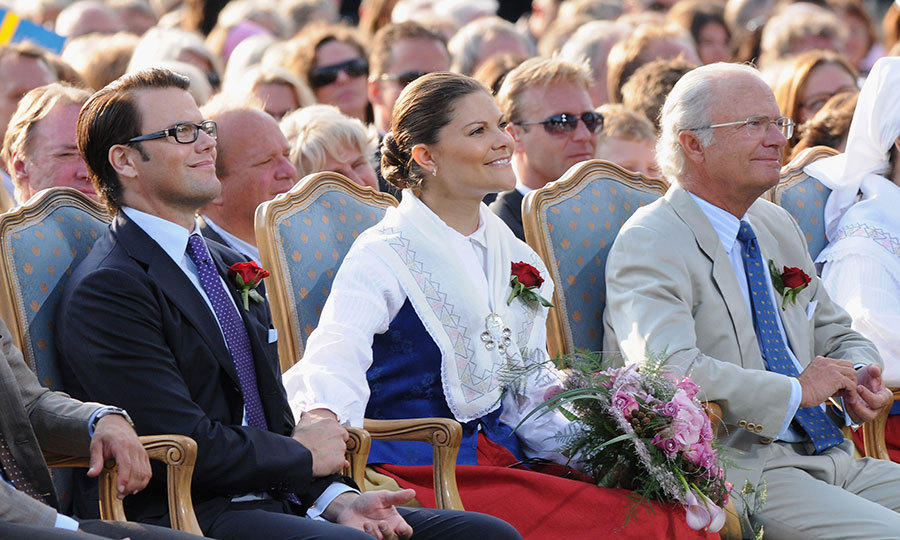Must be the music! Daniel and Victoria held hands as they sat next to her father King Carl XVI Gustaf during the Crown Princess's 32nd birthday concert at Borgholm's Idrottsplat in 2009. 