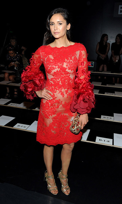 Nina Dobrev looked red hot in a lace embroidered dress at the Marchesa Spring/Summer 2017 fashion show co-hosted by FIJI Water.