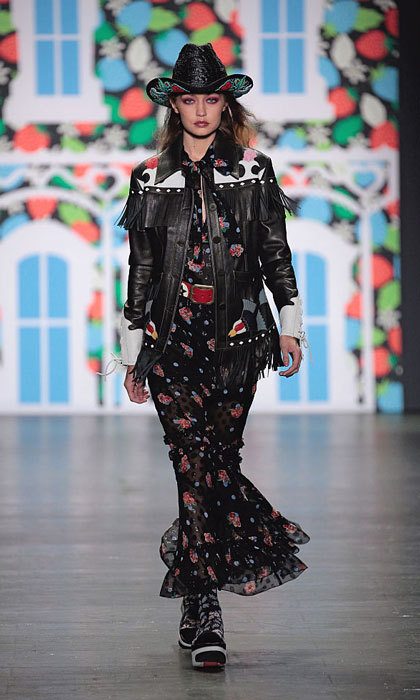 Gigi saddled up in a cowgirl-esque ensemble as she walked down the runway at the Anna Sui show.