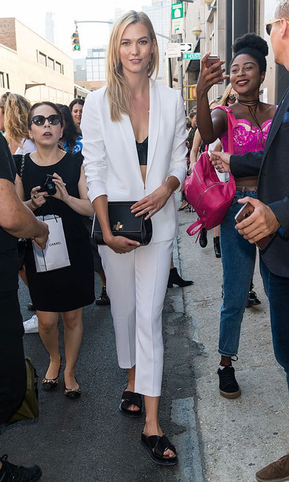 Karlie Kloss opted for a white blazer and matching trousers (sorry, Labor Day 'rule') paired with a black bralette for the Boss Womenswear fashion show.