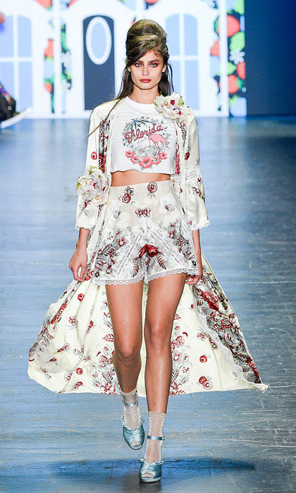 Victoria's Secret model Taylor Hill worked the runway of the Anna Sui show modeling printed shorts paired with a matching overcoat.