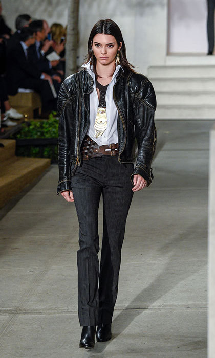 Kendall Jenner walked the runway modeling a black leather jacket, classic button down shirt and during trousers at Ralph Lauren Spring Summer 2017 fashion show.