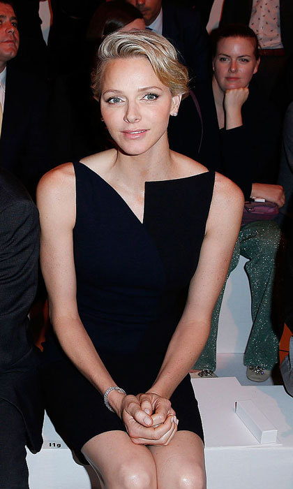 "<a href=""http://us.hellomagazine.com/tags/1/princess-charlene/""><strong>Princess Charlene</strong></a> of Monaco looked trés chic wearing a black dress featuring an asymmetrical neckline to the Akris show during Paris Fashion Week Womenswear Spring/Summer 2014.