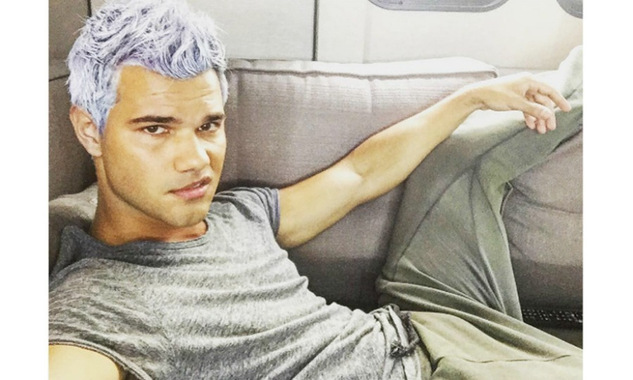 "Taylor Lautner took a break from the slow ""set life"" and snapped a photo of his new ice purple locs. 