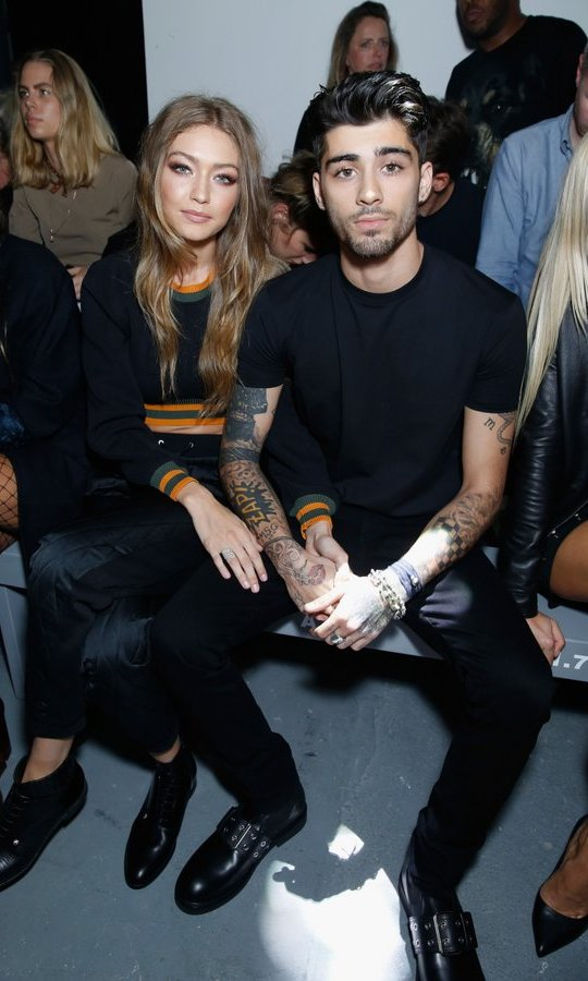 Gigi Hadid and Zayn Malik showed they are definitely back on at Versus Versace. 