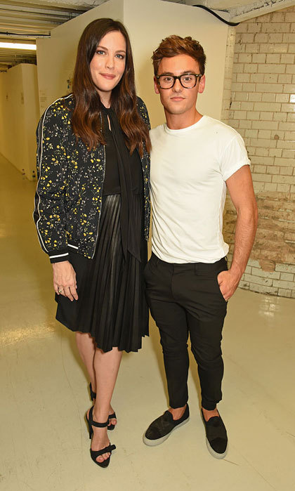 Liv Tyler posed with Olympic athlete Tom Daley at the Belstaff and Liv Tyler Celebrate the Launch of Spring Summer 17 event held at Victoria House.