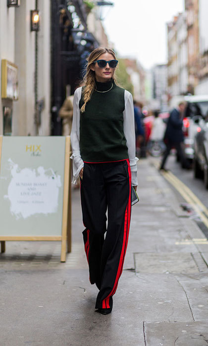 Olivia Palermo looked effortlessly cool strolling the streets of London wearing sunglasses and track suit pants.