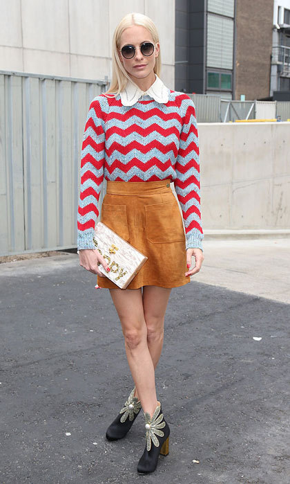 Poppy Delevingne made a vibrant appearance donning a zig zag printed sweater and suede skirt at the Erdem show. The model accessorized her look with embellished booties and a personalized cloth featuring her name.