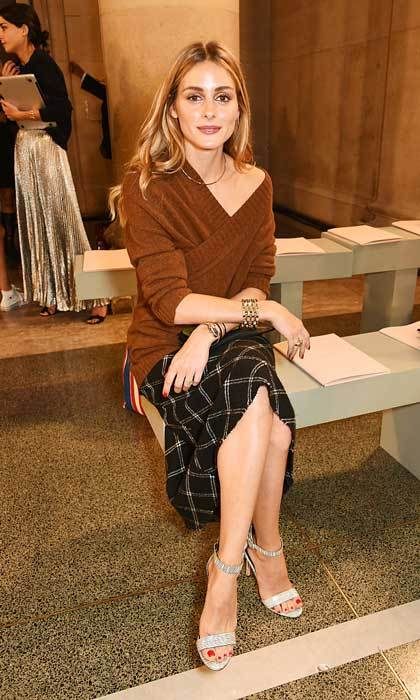 Olivia Palermo looked cozy-chic sitting in the front row of the Christopher Kane show wearing a tartan skirt and caramel sweater.  