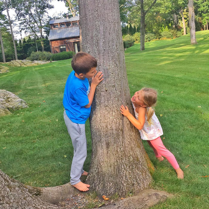 Sibling love! Gisele Bündchen shared a photo of her and Tom Brady's daughter Vivian playing hide and seek with one of her older brothers.