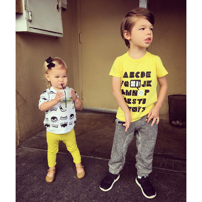 "Vanessa Lachey's daughter Brooklyn and son Camden were styling in coordinating yellow outfits. The expectant mom captioned the photo of her kids, ""Sibling Street Style! These kids look like they're up to no good, but they look darn cute coin it!""