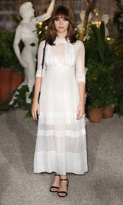 Felicity Jones was a vision in white sporting an ankle-length dress to the Burberry show during London Fashion Week.