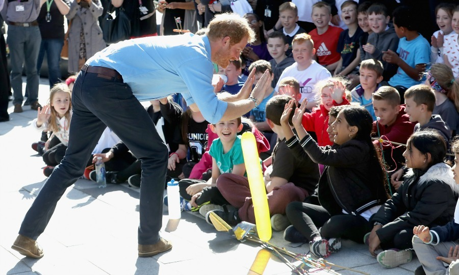 Prince Harry had enough hands for high fives for the children at the Streetsport initiative during his visit to  Robert Gordon University in Aberdeen, Scotland.