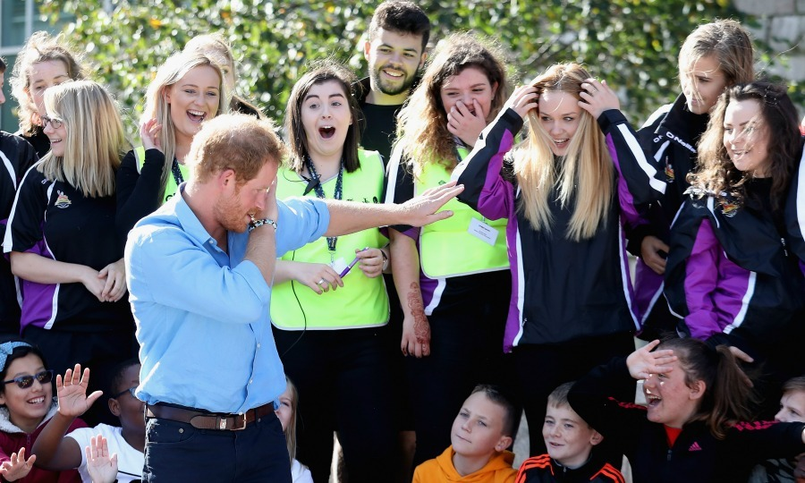 "Just like his older brother, Harry isn't afraid to bust a move. The fun royal surprised a group of girls when he hit ""the dab.""