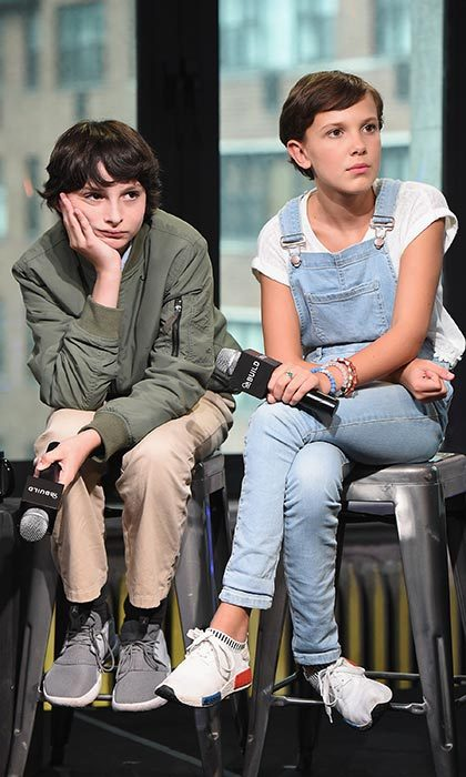 Alongside co-star Finn Wolfhard, the young actress looked on-trend sporting baby blue denim overalls and Adidas NMD shoes for the BUILD Series at the AOL HQ in New York City. 